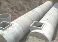 Réservoir cylindrique composé de tuyaux en béton
